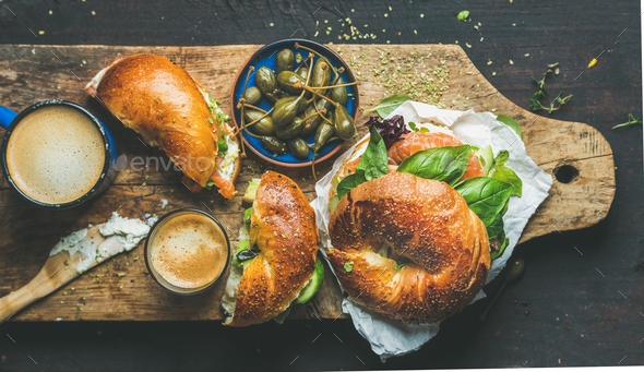 Breakfast with bagel, espresso coffee, capers on board, top view - Stock Photo - Images