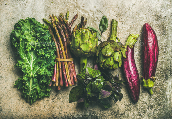 Flat-lay of fresh green and purple vegetables, top view - Stock Photo - Images