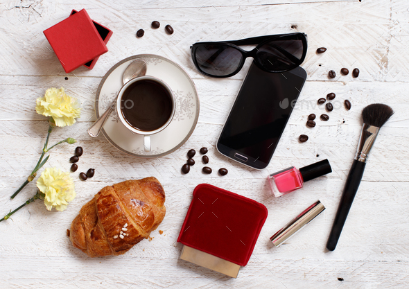 Coffee with croissant and make up tools - Stock Photo - Images