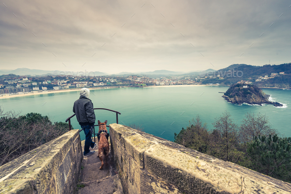 Man and german shepherd dog traveling together - Stock Photo - Images