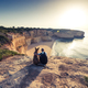 Best friends travellers sitting at cliffs in Portugal - PhotoDune Item for Sale