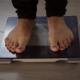 Female Measuring Weight on Health Scale - VideoHive Item for Sale
