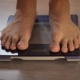 Man Measuring Weight with Health Scale. Closeup Legs - VideoHive Item for Sale