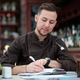 Caucasian male chef cook thinking about new menu or recepts. - PhotoDune Item for Sale
