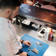 Chef is cutting raw shrimp with big special knife - PhotoDune Item for Sale