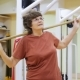 Elderly Woman Swinging with Stick, Doing Physiotherapy Exercises in Fitness Room. Healthy Gymnastics - VideoHive Item for Sale