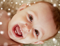 close up of happy little baby boy or girl face