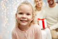 happy little girl with family at christmas