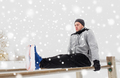 young man exercising on parallel bars in winter