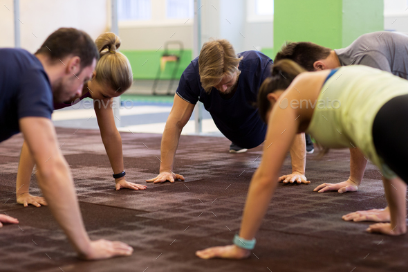 group of people exercising in gym - Stock Photo - Images