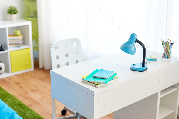 kids room interior with table and school staff - Stock Photo - Images