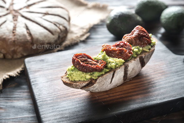 Sandwich with guacamole and sun-dried tomatoes - Stock Photo - Images