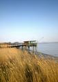 Huts facing the river