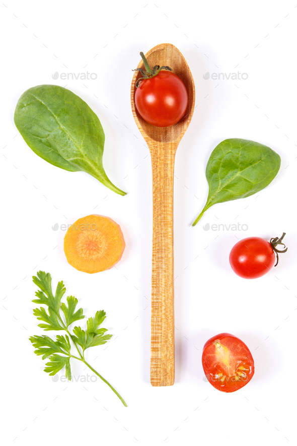 Fresh vegetables with spoon on white background, healthy food concept - Stock Photo - Images