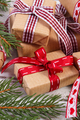Wrapped gifts with colorful ribbon and spruce branches for Christmas or Valentines
