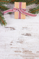 Wrapped gift and spruce branches for Christmas or Valentines, copy space for text on rustic board
