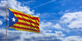 Catalonia flag waves under the blue sky with many white clouds. 3d illustration