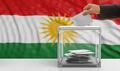 Elections in Kurdistan. Man's hand voting with a waving Kurdistan flag background, 3d illustration