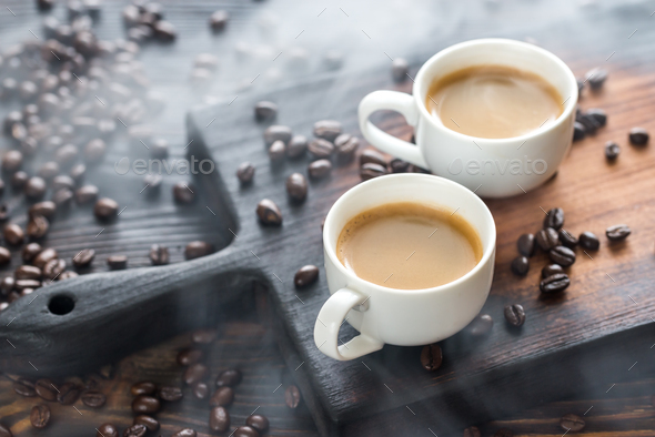 Two cups of coffee with coffee beans - Stock Photo - Images