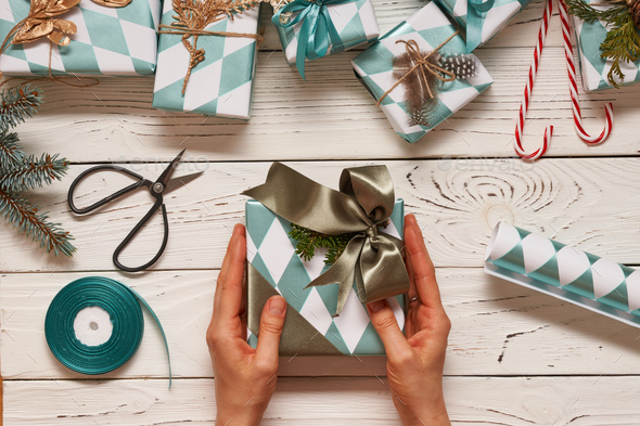 Woman Wring Christmas Presents Over Wooden Background Stock Photo Images