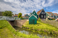 Characteristic Dutch village scene with wooden houses and bridge