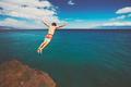 Friends cliff jumping into the ocean - PhotoDune Item for Sale