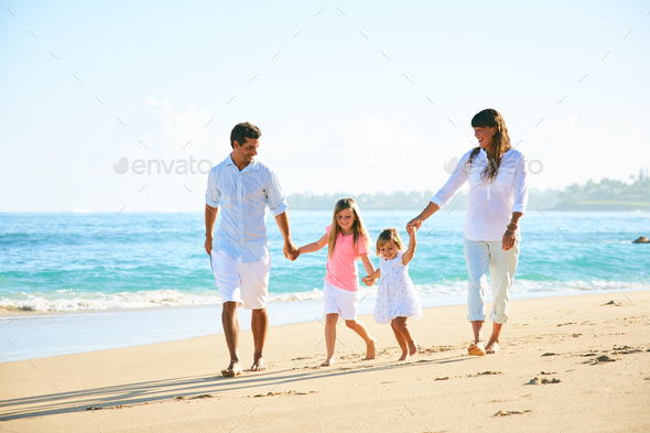Happy Family on the Beach - Stock Photo - Images