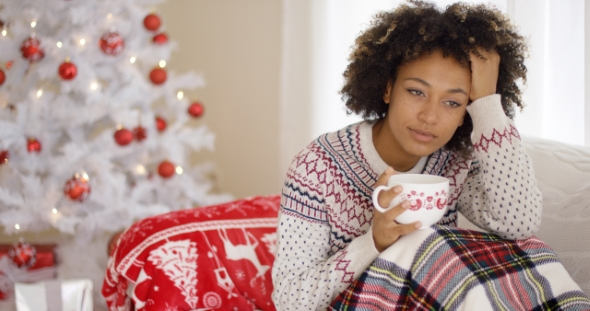 Pensive Young Woman Celebrating a Lonely Christmas