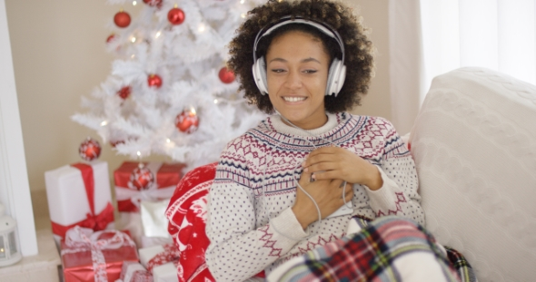 Happy Woman Enjoying Her Music at Christmas