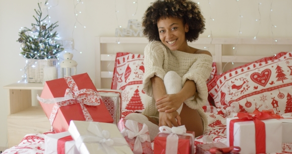 Happy Young Woman Surrounded By Christmas Gifts
