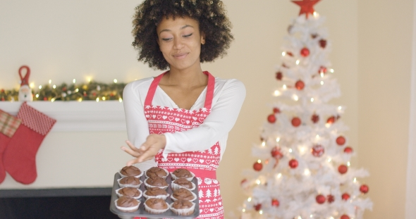 Proud Young Cook Displaying Her Christmas Muffins