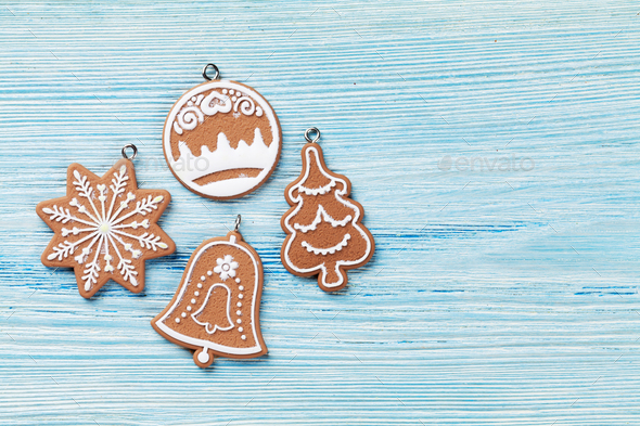 Christmas wooden background with gingerbread cookies - Stock Photo - Images