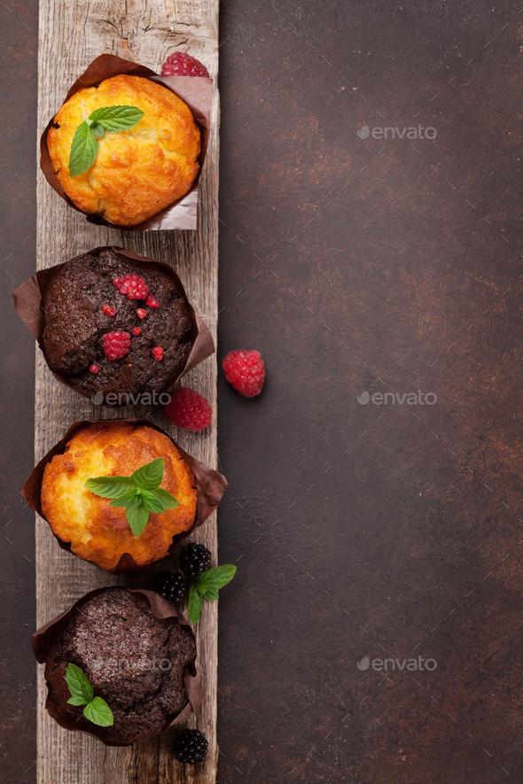 Muffins with berries and mint - Stock Photo - Images