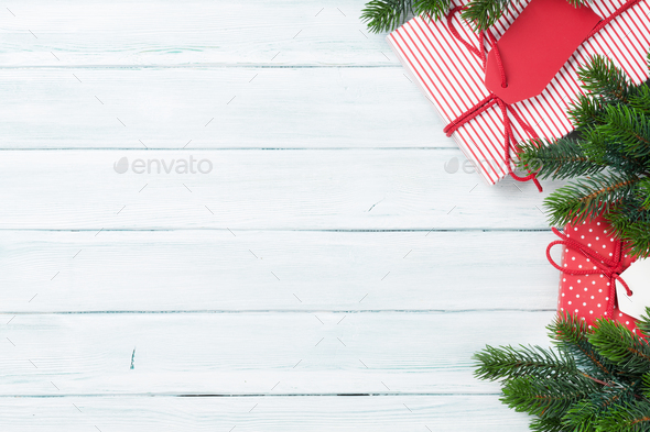 Christmas gift boxes and fir tree - Stock Photo - Images