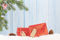 Christmas gift box and fir tree branch in snow - PhotoDune Item for Sale