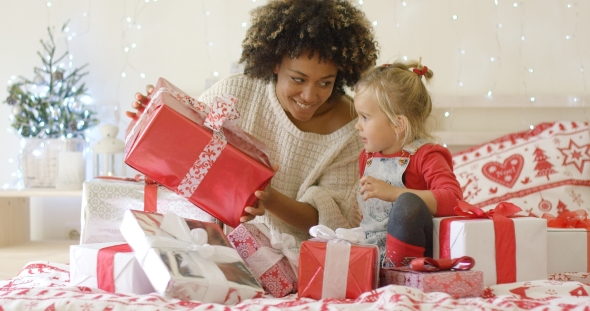 Mother Showing Child a Large Christmas Gift