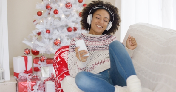 Young Girl Relaxing Listening To Christmas Music