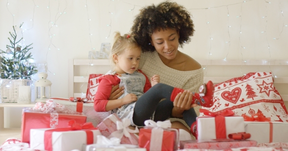 Daughter and Mother in Bed with Christmas Gifts