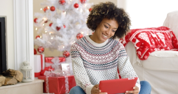 Young Woman Surfing the Internet at Christmas