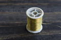Spool of Golden Thread