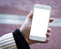 Mockup image of womans hand holding white mobile phone