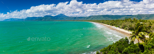 Port Douglas four mile beach and ocean on sunny day, Australia - Stock Photo - Images