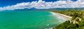 Port Douglas four mile beach and ocean on sunny day, Australia