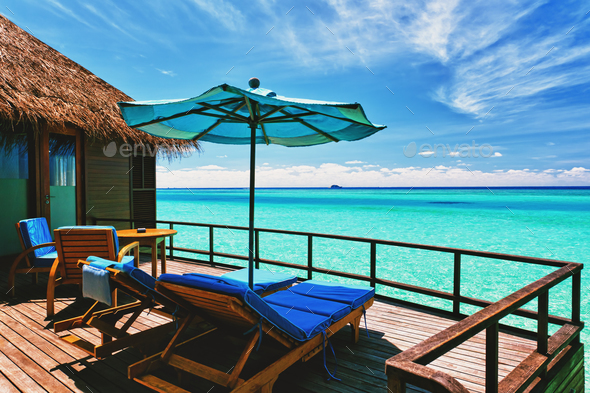 Overwater villa balcony overlooking tropical lagoon - Stock Photo - Images