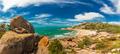 Horseshoe Bay at Bowen - iconic beach with granite climbing rock