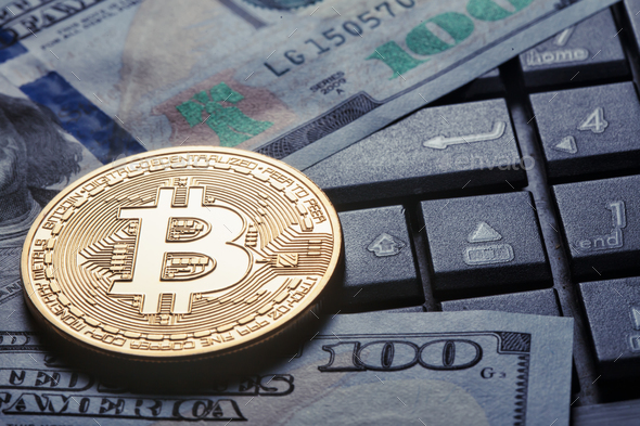Virtual currency bitcoin against the background of dollars and c - Stock Photo - Images