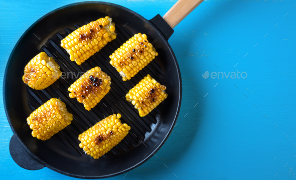 Hot baked corn in a frying pan - Stock Photo - Images