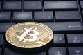 Golden bitcoin on the computer keyboard - PhotoDune Item for Sale