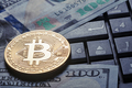 Virtual currency bitcoin against the background of dollars and c - PhotoDune Item for Sale