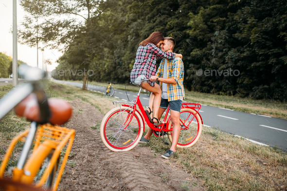 Man and woman kissing on retro bike - Stock Photo - Images